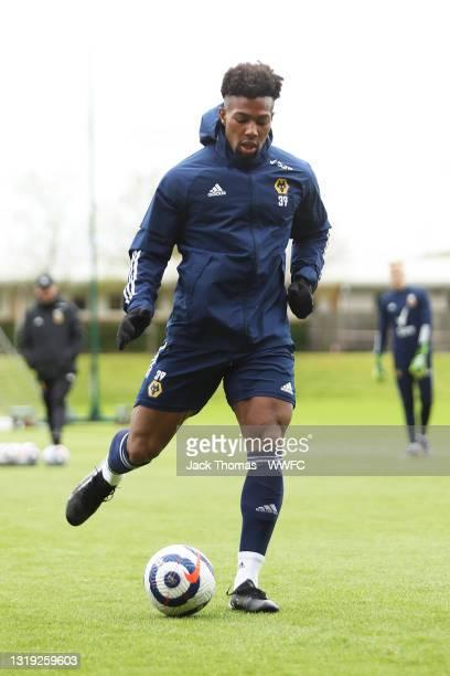 Adama Traore of Wolverhampton Wanderers runs with the ball during a Wolverhampton Wanderers Training Session at Sir Jack Hayward Training Ground on...