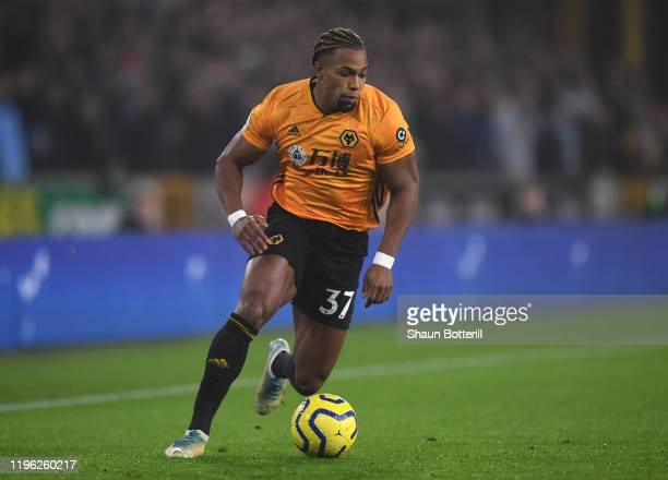 Adama Traore of Wolverhampton Wanderers runs with the ball during the Premier League match between Wolverhampton Wanderers and Manchester City at...