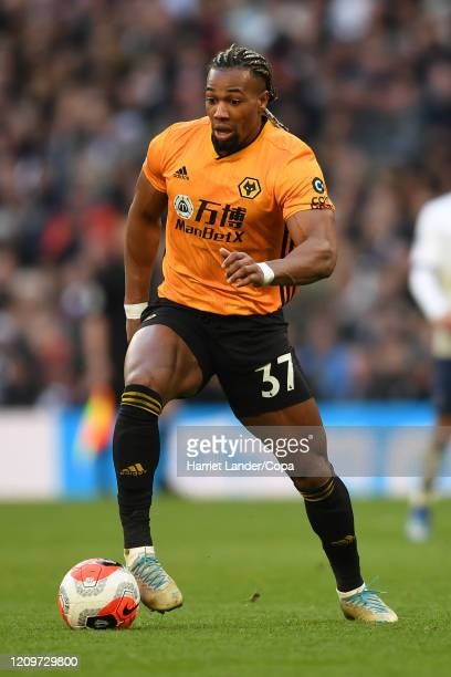 Adama Traore of Wolverhampton Wanderers runs with the ball during the Premier League match between Tottenham Hotspur and Wolverhampton Wanderers at...