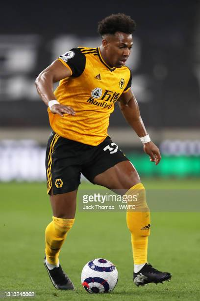Adama Traore of Wolverhampton Wanderers runs with the ball during the Premier League match between Wolverhampton Wanderers and Sheffield United at...