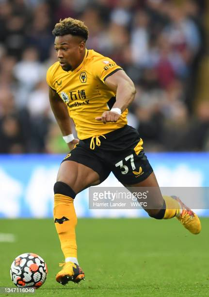 Adama Traore of Wolverhampton Wanderers runs with the ball during the Premier League match between Aston Villa and Wolverhampton Wanderers at Villa...
