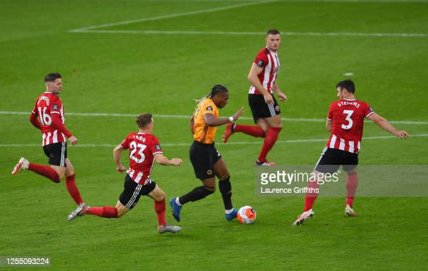 Adama Traore of Wolverhampton Wanderers runs with the ball under pressure from Ollie Norwood, Ben Osbourne, Jack O'Connell and Enda Stevens of...