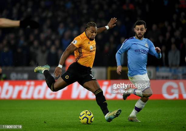 Adama Traore of Wolverhampton Wanderers scores a goal to make it 1-2 during the Premier League match between Wolverhampton Wanderers and Manchester...