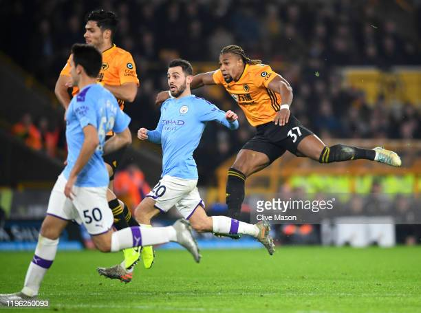 Adama Traore of Wolverhampton Wanderers scores his sides first goal during the Premier League match between Wolverhampton Wanderers and Manchester...