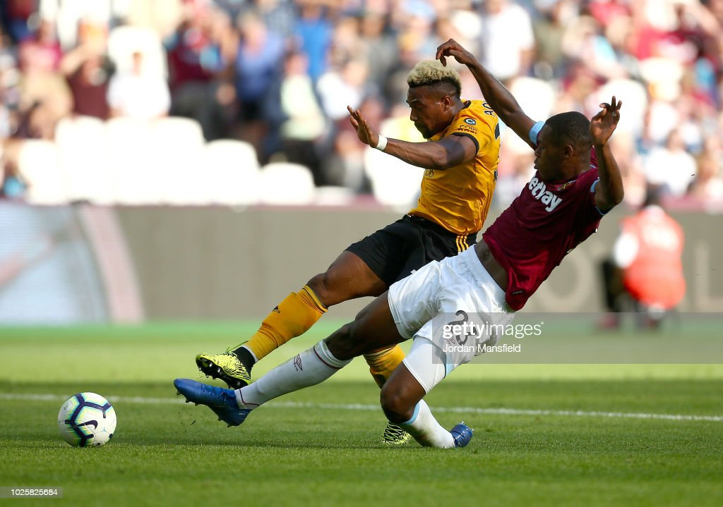 Adama Traore of Wolverhampton Wanderers scores his team's first goal during the Premier League match between West Ham United and Wolverhampton Wanderers at London Stadium on September 1, 2018 in London, United Kingdom.