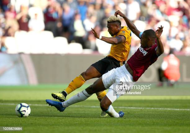 Adama Traore of Wolverhampton Wanderers scores his team's first goal during the Premier League match between West Ham United and Wolverhampton...