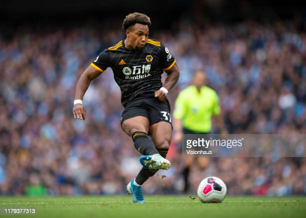 Adama Traore of Wolverhampton Wanderers scores the first goal during the Premier League match between Manchester City and Wolverhampton Wanderers at...