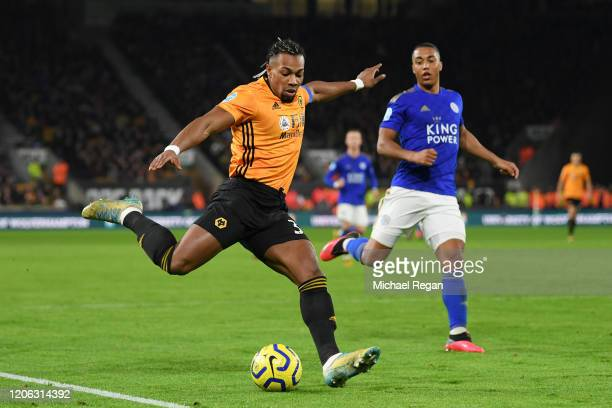 Adama Traore of Wolverhampton Wanderers shoots as Youri Tielemans of Leicester City looks on during the Premier League match between Wolverhampton...