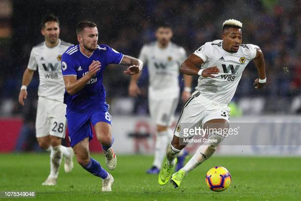 Adama Traore of Wolverhampton Wanderers tracked by Joe Ralls of Cardiff City during the Premier League match between Cardiff City and Wolverhampton...