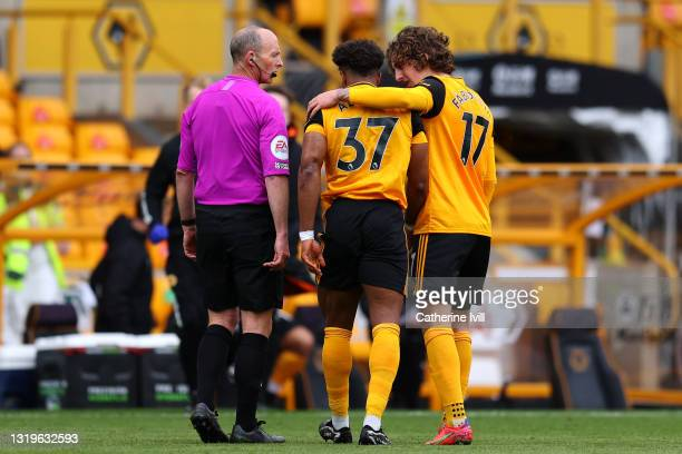 Adama Traore of Wolverhampton Wanderers walks off the pitch injured during the Premier League match between Wolverhampton Wanderers and Manchester...