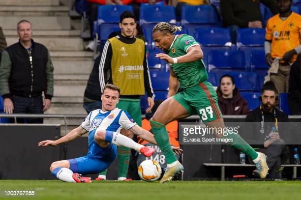 Adama Traore of Wolves dribbles Adria Pedrosa of Espanyol during the UEFA Europa League round of 32 second leg match between Espanyol Barcelona and...