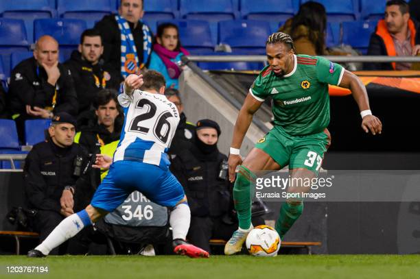 Adama Traore of Wolves dribbles Pol Lozano of Espanyol during the UEFA Europa League round of 32 second leg match between Espanyol Barcelona and...
