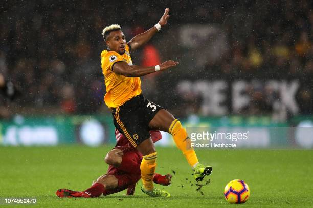 Adama Traore of Wolves is tackled by Fabinho of Liverpool during the Premier League match between Wolverhampton Wanderers and Liverpool FC at...