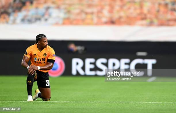 Adama Traore of Wolves takes a knee in support of the Black Lives Matter movement during the UEFA Europa League round of 16 second leg match between...