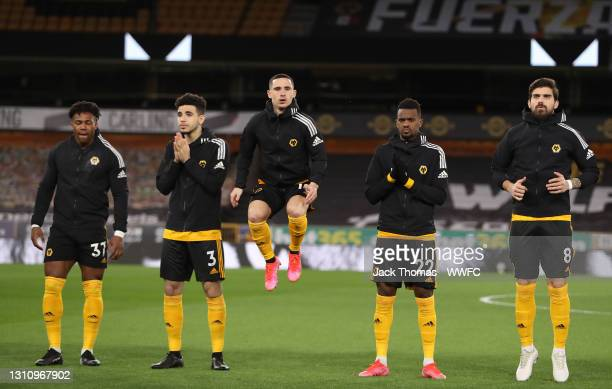 Adama Traore, Rayan Ait-Nouri, Daniel Podence, Nelson Semedo and Ruben Neves of Wolverhampton Wanderers line up prior to the Premier League match...