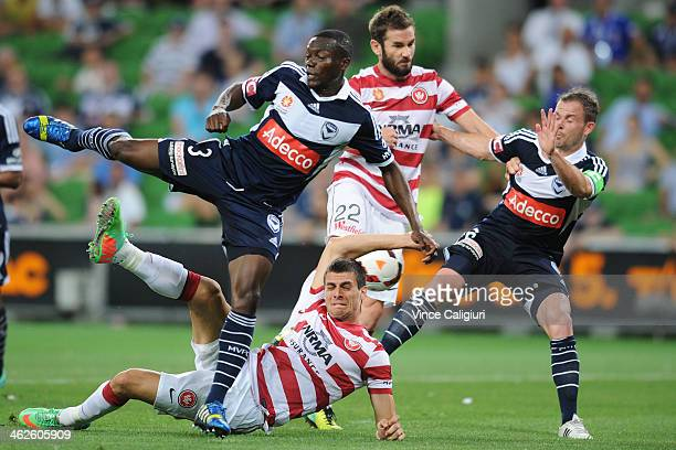 Adama Traore Tomi Juric Dean Heffernan and Leigh Broxham contest for the ball during the round 19 ALeague match between Melbourne Victory and the...