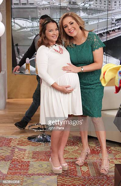 Adamari Lopez and Ana Maria Canseco pose during Adamari Lopez's baby shower at Telemundo Studio on February 6 2015 in Miami Florida