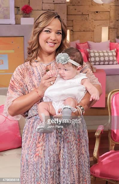 Adamari Lopez returns to the set of Un Nuevo Dia and poses with her daughter Alaiaiat Telemundo Studio on July 6 2015 in Miami Florida