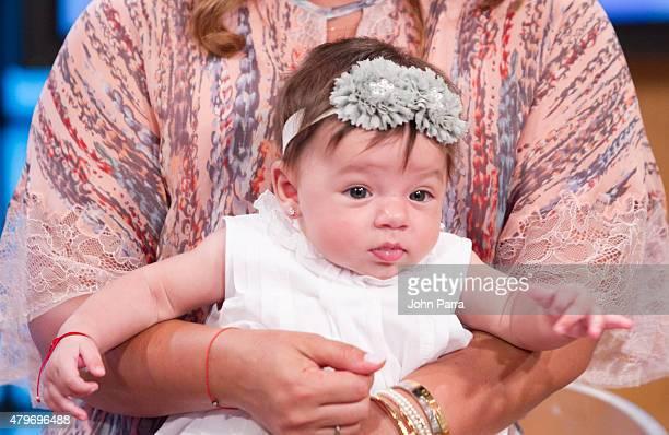 Adamari Lopez returns to the set of Un Nuevo Dia and poses with her daughter Alaiaiat Telemundo Studio on July 6 2015 in Miami Florida t