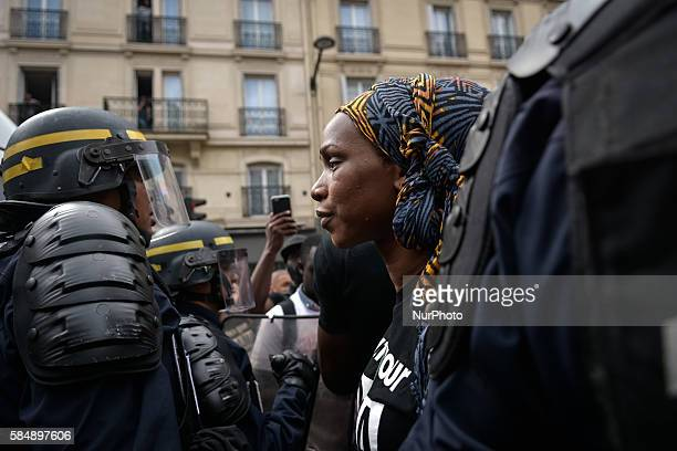 Adama's sister Assa talks to a French anti riot policeman as demonstrators take part in a march to protest at the death of Adama Traore in front of...
