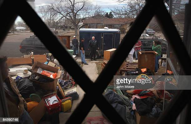 Adams Country sheriff's deputy Greg Barnett looks on after an eviction team carried out a family's belongings during a foreclosure eviction February...