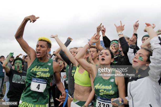 Adams State University teammates cheer with Elias Geydon during the Division II Men's Cross Country Championship held at the Angel Mounds on November...