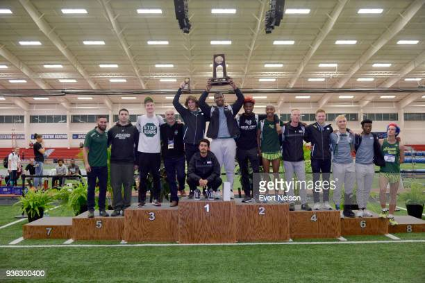 Adams State's track and field team poses with the third place trophy during the Division II Men's and Women's Indoor Track Field Championships at...