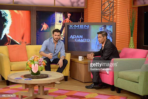 Adan Canto and Johnny Lozada on the set of Despiereta America at Univision Headquarters on May 19 2014 in Miami Florida