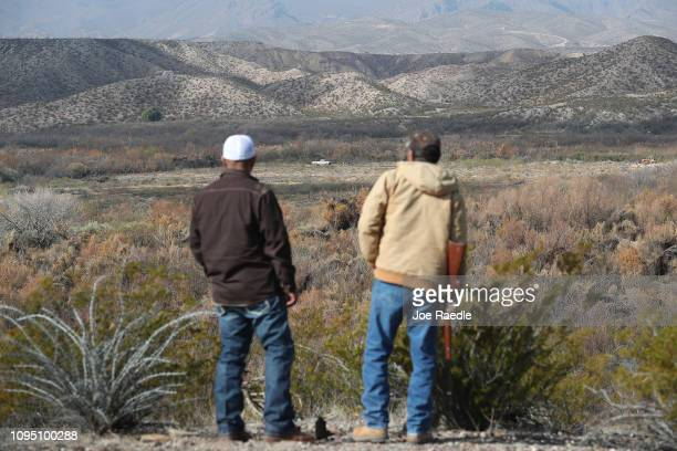 Adan Madrid and his father Adan Madrid sr look out towards Mexico from their ranch that abuts the Rio Grande river which marks the border between...