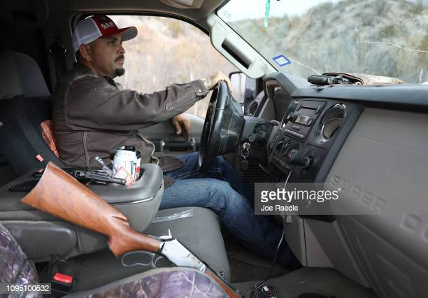Adan Madrid drives his truck on his ranch that abuts the Rio Grande river which marks the border between Mexico and the United States on January 16...