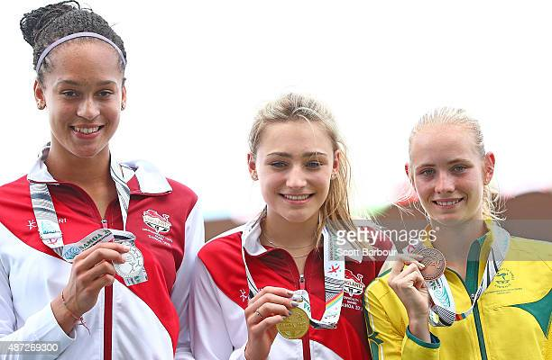 Ada'ora Chigbo of England Niamh Emerson of England and Paige Wilson of Australia pose with their medals after the medal presentation for the Girls...