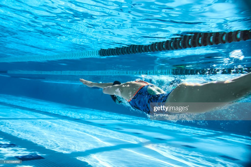 Adaptive Athlete diving into the swimming pool. : Stock Photo