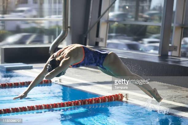 Adaptive Athlete diving into the swimming pool.