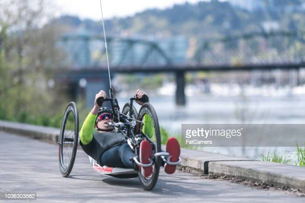 Adaptive athlete does a training ride on his handcycle