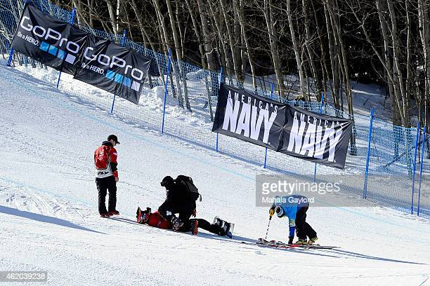Adaptive athlete Mike Schultz takes a fall breaking his ankle and taking him out of competition during the Snowboarder X Adaptive Semifinals Friday...