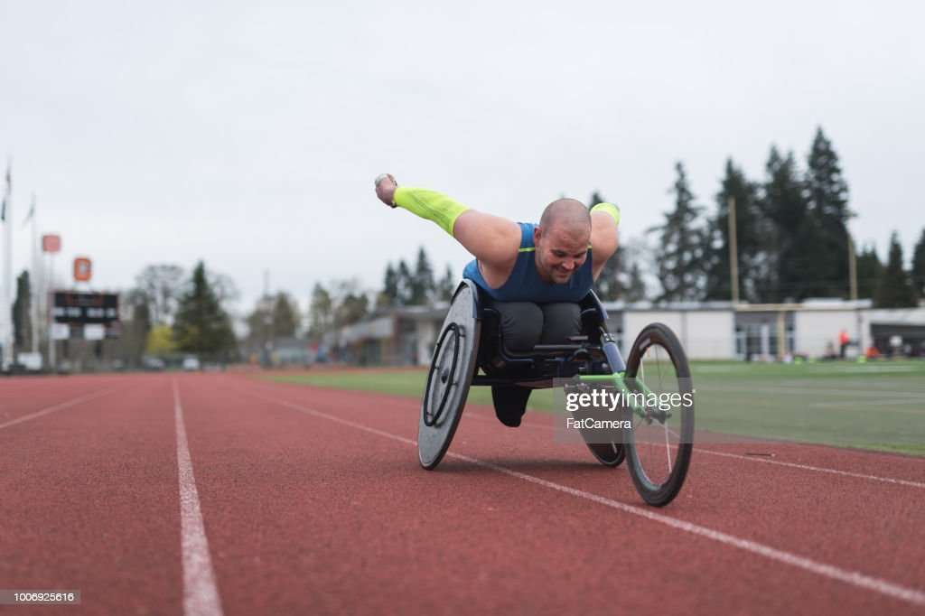 Adaptive athlete training on his racing wheelchair : Stock Photo