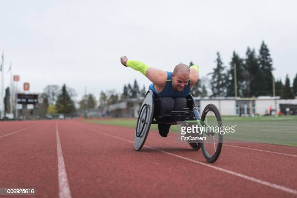 adaptive athlete training on his racing wheelchair - paraplegic stock photos and pictures