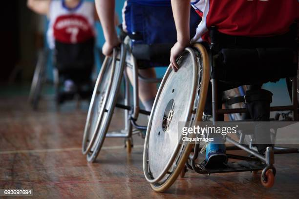 adaptive athletes moving on wheelchairs - cliqueimages stock-fotos und bilder