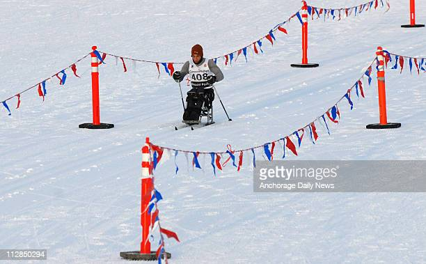 Adaptive skier Eric Frazier passes through the stadium while competing in 15-K sit ski race during the second day of the U.S. Cross Country Ski...