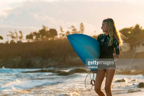 adaptive surfer getting ready to go into the ocean - disabilitycollection stock pictures, royalty-free photos & images