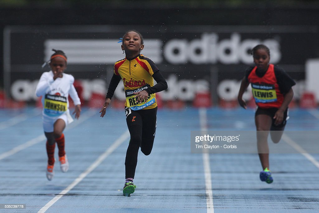 Adaria Reaves USA, (centre), winning the Girls' Fastest Kid 100m during