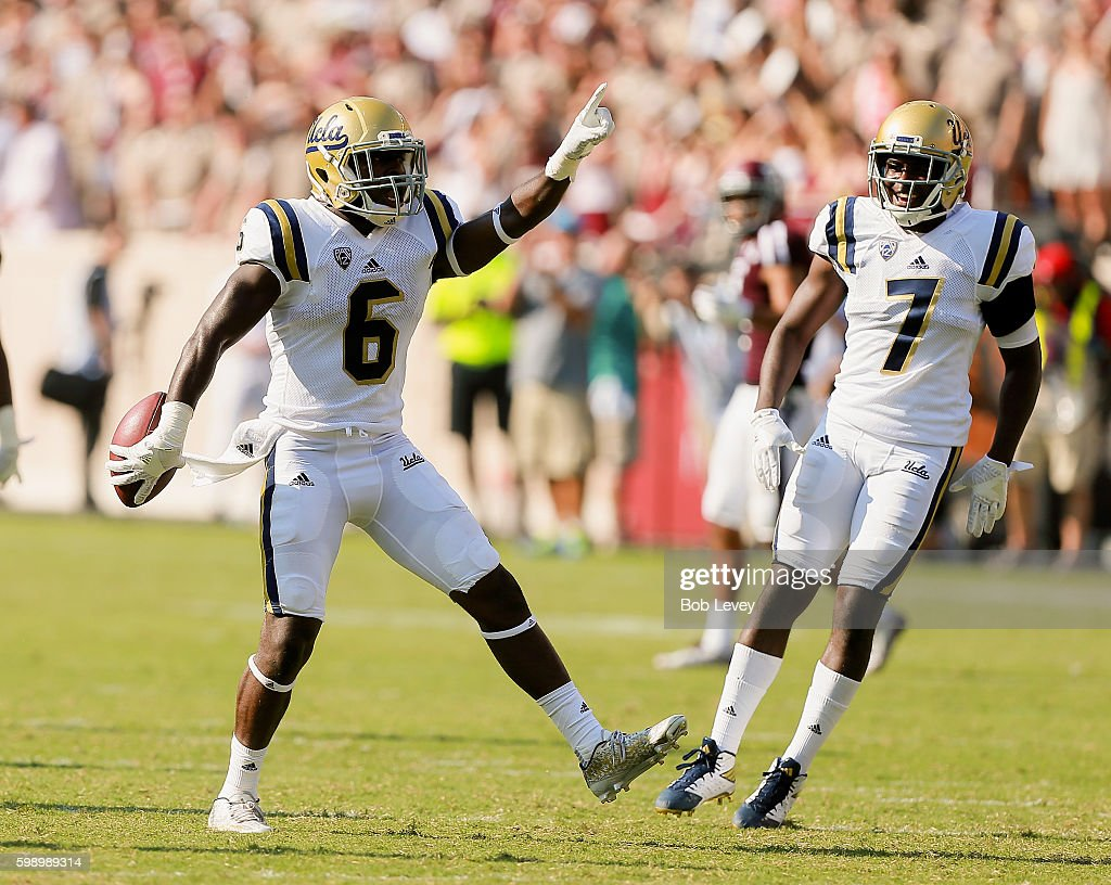 Adarius Pickett #6 of the UCLA Bruins celebrates his interception with Darren Andrews #7 in the third quarter against the Texas A&M Aggies at Kyle Field on September 3, 2016 in College Station, Texas.
