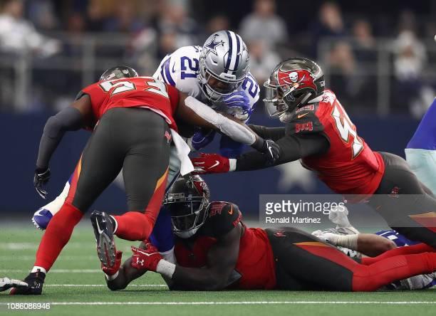 Adarius Taylor, Devante Bond, and Jason Pierre-Paul of the Tampa Bay Buccaneers combine to stop Ezekiel Elliott of the Dallas Cowboys in the third...
