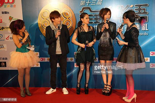 Adason Loi Gillian and Charlene Choi of Hong Kong speaks during the red capet prior to the start of the 13th Global Chinese Music Awards at Putra...