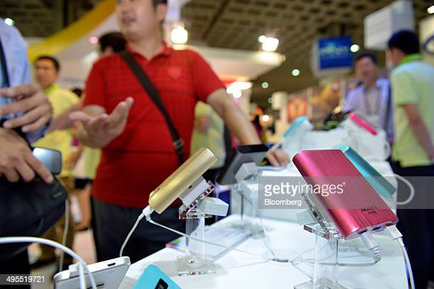 Adata Technology Co Power Bank chargers are displayed during the Computex Taipei 2014 expo at the Taipei Nangang Exhibition Center in Taipei Taiwan...