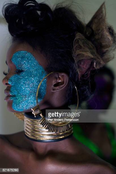 Adau Mornyang a model walking for the designer David Tlale waits backstage before a show on August 1 2015 at Gallery MOMO in Cape Town South Africa...