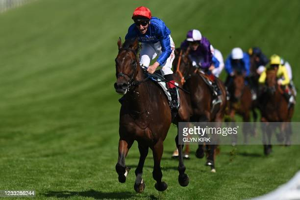 Adayar ridden by Adam Kirby wins the Epsom Derby on the second day of the Epsom Derby Festival horse racing event at Epsom Downs Racecourse in...