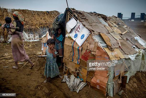 Addi stands in front of his tent consisting of mostly carboard and located in the IDP refugee camps of Sittwe for Rohingya Sittwe now has over 125000...