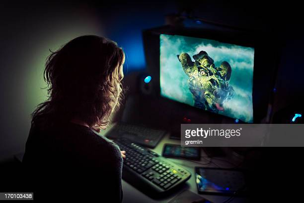 addicted computer gamer playing late at night - gamer stock pictures, royalty-free photos & images