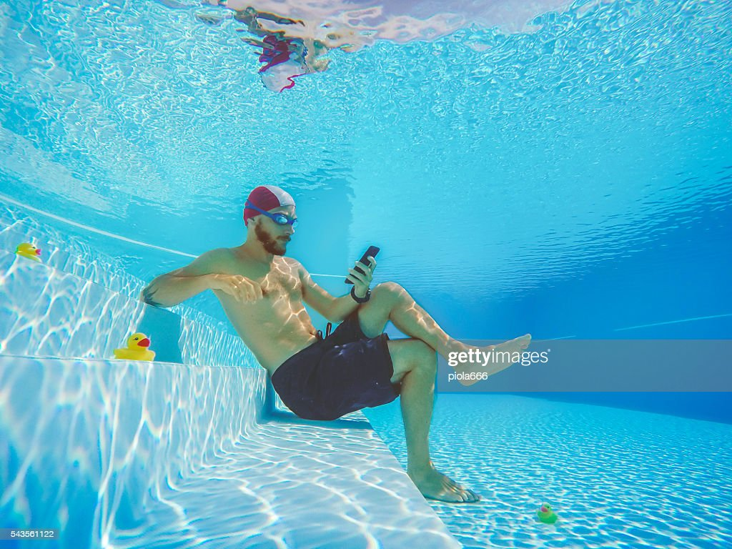 Addicted to social networking: with mobile phone underwater : Stock Photo